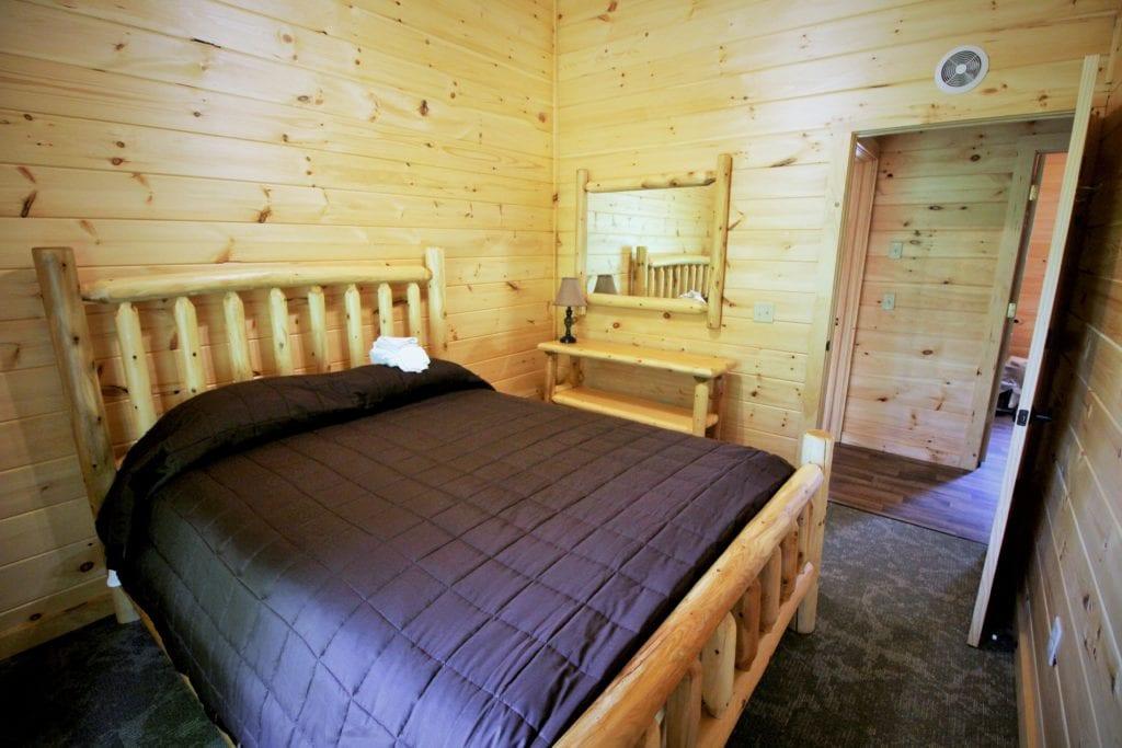 Bedroom in Family Cabin Rentals